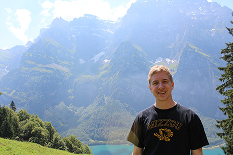 Andrew Allee in front of mountains