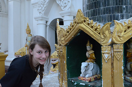 Jessica Anania posing in front of a Buddha statue