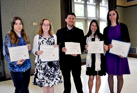 Sarah Judd, Erin Niederberger, Connor Flood, Andrea Ares and Erin Pettey holding awards