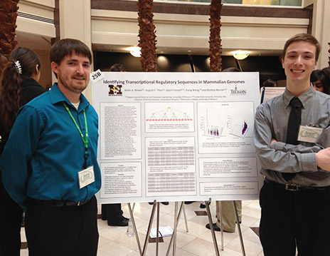 Kalen Brown and Gus Thies in front of their research poster