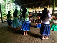 Taking in a traditional welcome dance by the Añangu community.