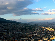 A view of Quito from the large statue of the winged angel on El Panecillo, a small hill rising above the city.
