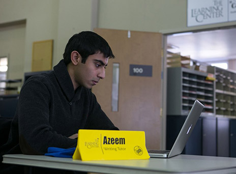 Azeem Khan in the Writing Center