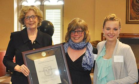 Nicole Monnier receiving award