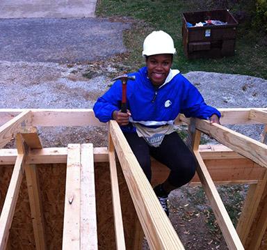 Tia Paulette building a house.