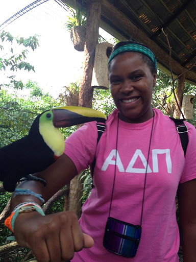 Tia Paulette posing with a toucan in Costa Rica.