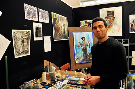 Simom Tatum with his artwork.